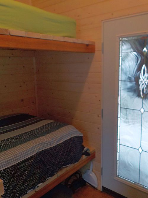 bunk beds and door of the hut